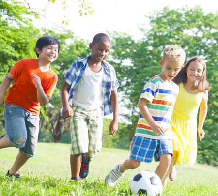 Children Playing Football Holidays Summer Concept