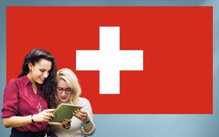 swiss culture: Switzerland National Flag Studying Women Students Concept Stock Photo