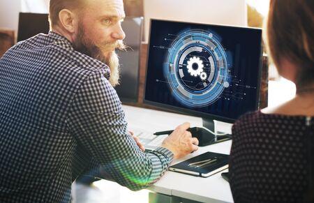 man using computer: Technology Digital Network Cog Teamwork Concept