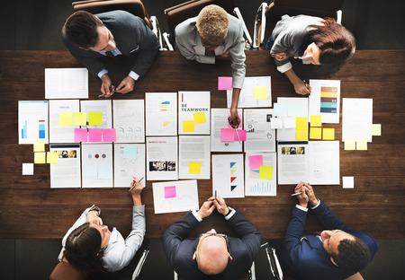 organization: Business People Analyzing Statistics Financial Concept