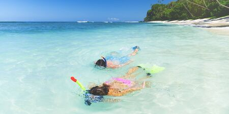 snorkelling: Couple Snorkelling Summer Beach Vacation Concept Stock Photo