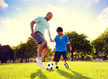 playing: Father Son Playing Soccer Park Summer Concept