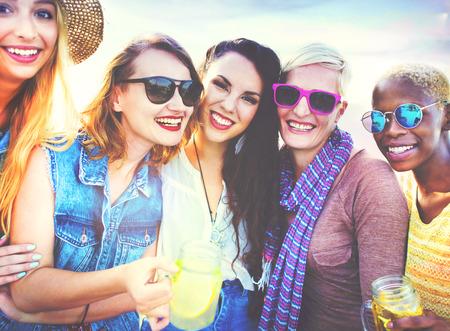 summer day: Diverse Beach Summer Girls Friends Bonding Concept Stock Photo