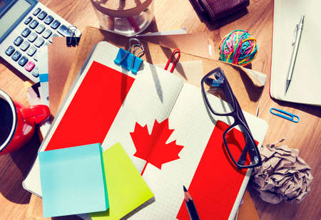 messy: Canada Flag Stationery Office Desk Messy Concept Stock Photo