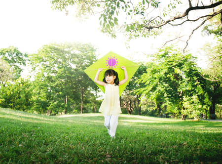 asian natural: Little Girl Flying Kite Playing Cheerful Activity Concept