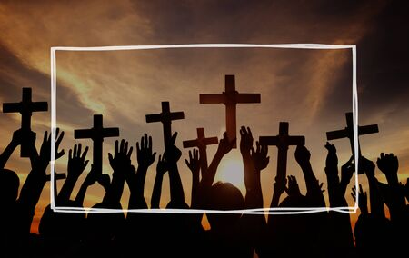 back lit: Group of People Holding Cross and Praying in Back Lit