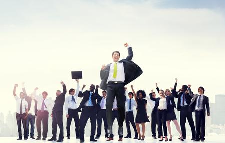 manos levantadas: Business People Hands Raised Rooftop City Concept