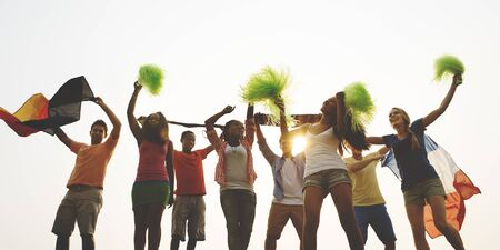 squad: Group Casual People Cheering Outdoors Concept Stock Photo