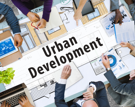 Business meeting with urban development concept