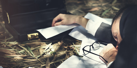 lay down: Businessman Tired Lay Down Sleep Parcel Letter Concept