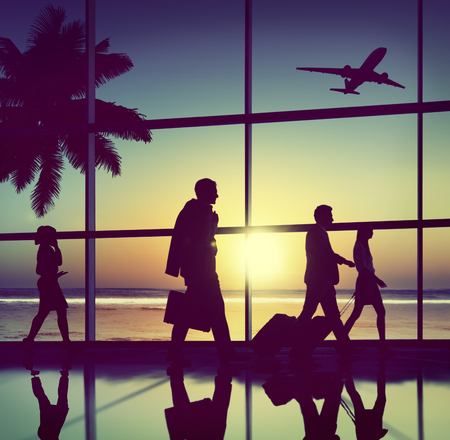 back lit: Back Lit Business People Traveling Airplane Airport Concept