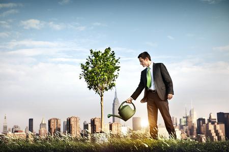 prosperidad: El hombre de negocios para empresarios Beneficio A partir del concepto Foto de archivo