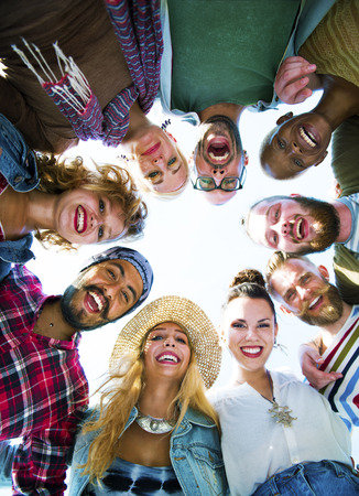 holiday party: Friends Huddle Join Holiday Party Group Concept Stock Photo