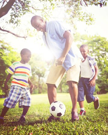 father and child: African Family Happiness Holiday Vacation Activity Concept