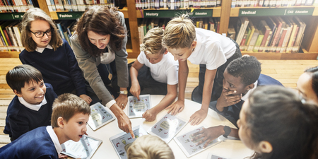 School Teacher Teaching Students Learning Concept Stock Photo