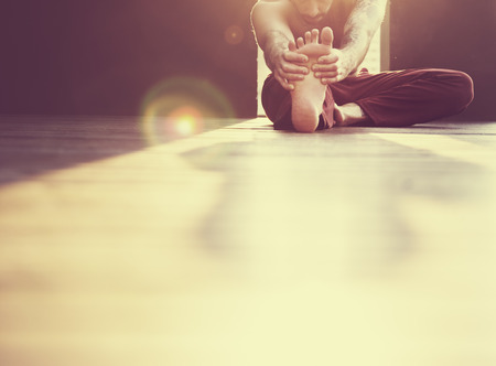 man alone: Man Yoga Practice Pose Training Concept Stock Photo