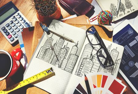 messy: Messy Designers Table with Sketch and Tools Concept
