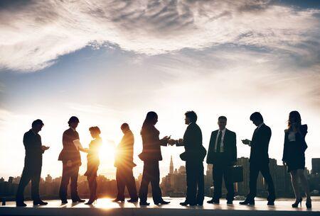 bustle: Back Lit Business Colleagues Occupation Teamwork Concept