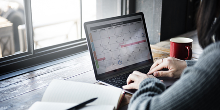 woman typing: Planner Organizer Date Events Schedule Concept