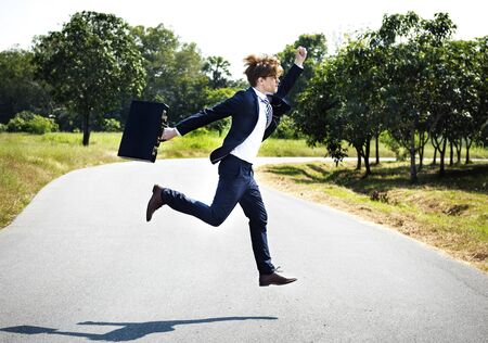 aspirations: Businessman Running Jumping Aspirations Environment Concept