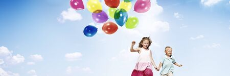 little girl child: Little Girl and Boy Outdoors Holding Balloons Concept