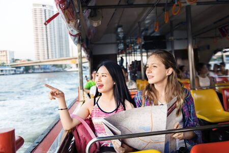 hangout: Girls Friendship Hangout Traveling Holiday Map Concept Stock Photo