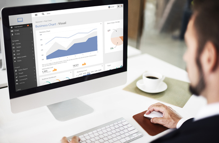 man using computer: Business Chart Visual Graphics Report Concept