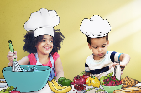 mixed race girl: Children Kids Cooking Kitchen Fun Concept Stock Photo