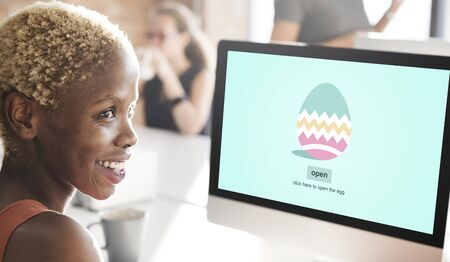 african woman at work: Easter Egg Holiday Concept