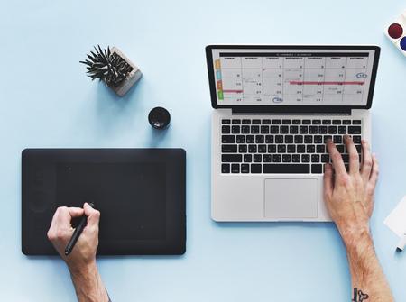 desk calendar: Computer Laptop Calendar Schedule Desk Concept Stock Photo