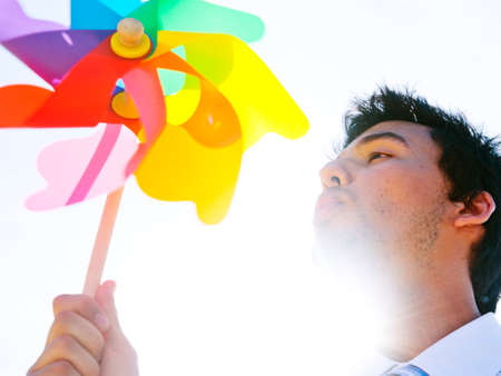 blowing of the wind: Businessman Blowing Wind Summer Power Energy Concept Stock Photo
