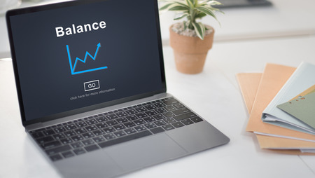 Online balance checking concept on laptop