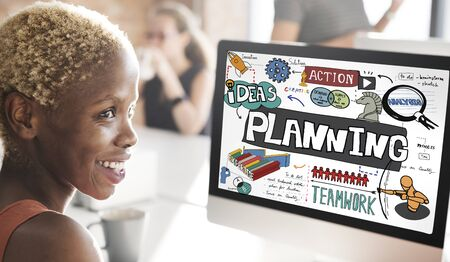 african woman at work: Planning Action Ideas Strategy Teamwork Concept
