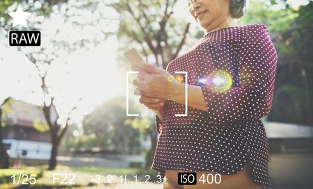 shutter speed: Senior Asian Woman Using Social Media