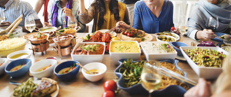 Friends Party Buffet Enjoying Food Concept Stock Photo