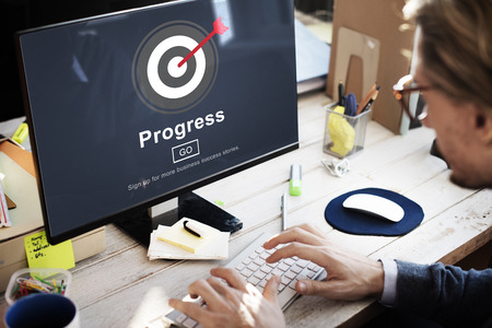 Businessman using a desktop computer with Progress concept