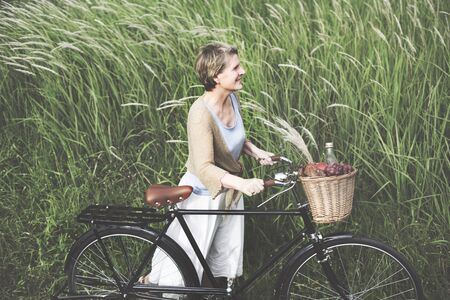 carefree: Woman Senior Bicycle Carefree Freshness Peaceful Concept