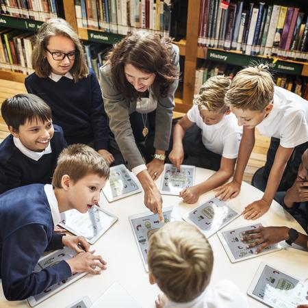 Education School Teacher Student Digital Tablet Technology Concept