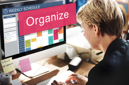 Woman at work with weekly schedule on screen Stockfoto - 109217935