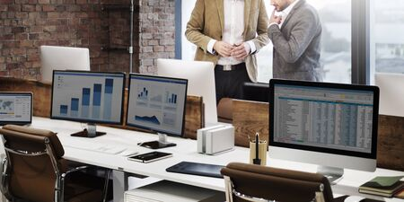 spread sheet: Businessmen Discussion Finance Planning Growth Concept Stock Photo