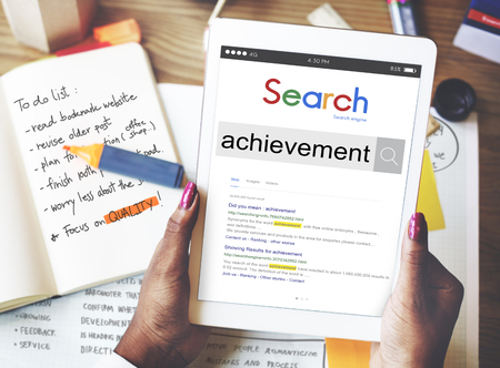 Online search for achievement on digital tablet 스톡 콘텐츠