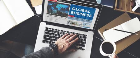 Global business news on laptop Stock fotó
