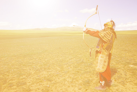 independent mongolia: Full Armored Archer Aiming To Shoot Concept