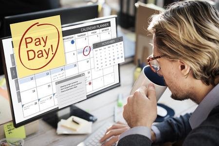 Man looking at his digital reminder Stockfoto - 109439836