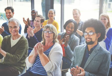 ovation: Group of Cheerful People Clapping with Gladness Stock Photo