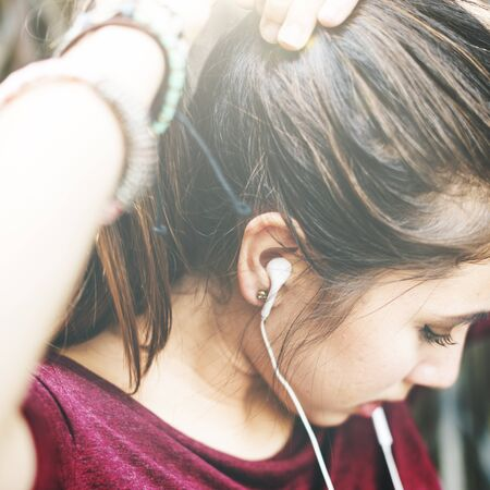 tied up: Woman Listening Music Media Tied Up Ponytail Concept Stock Photo