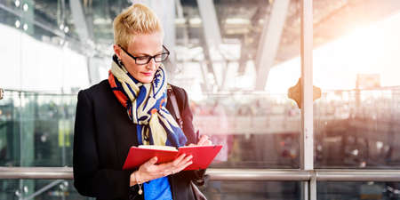 public transfer: Businesswoman Writing Waiting Flight Concept