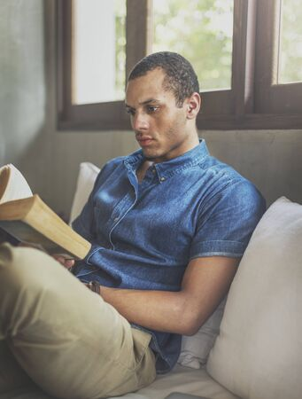 concentration: Man Reading Book Concentration Sitting Concept