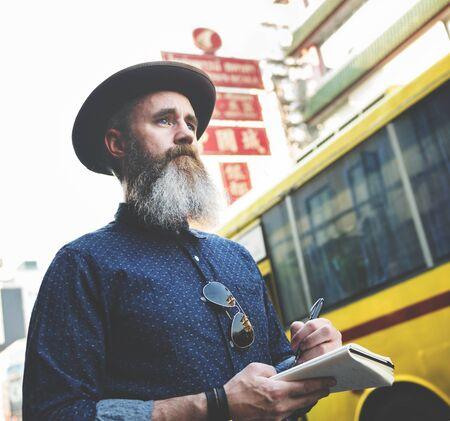 exploring: Man Journal Exploring Tourism Concept Stock Photo