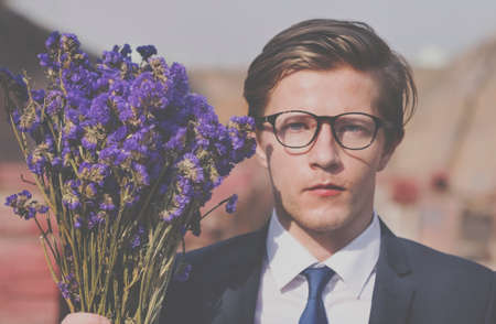 job posting: Businessman Purple Flower Holding Concept Stock Photo